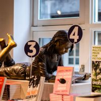 Statue of a Reading Girl in Scheltema Booksellers