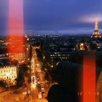 eiffel tower at night from arc de triomphe