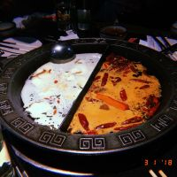 """Hot pot, a """"Melting Pot-type"""" dining experience where you cook your meats and vegetables in the boiling sauces"""