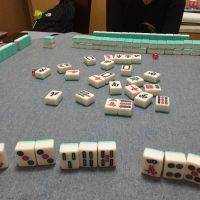 Learning to play mahjong (麻将, májiàng), a traditional Chinese game