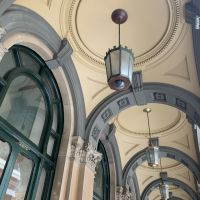Standing under the colonnades of the General Post Office.