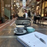 Working on my Modern Australian Art and Cinema assignment with a glass of tea at a cafe in the middle of the arcade.