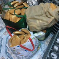 A truly unbelievable amount of bread (four overflowing bags and boxes)