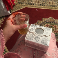 A glass of tea and a box...what's in it?