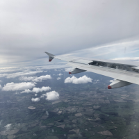 The view from an airplane window as the plane lands in London.