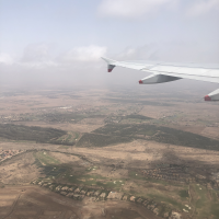The photo shows the view from an airplane taking off from Marrakesh.