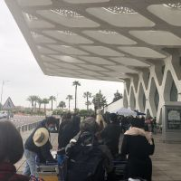 A line of people waiting to check in at the Marrakesh airport.
