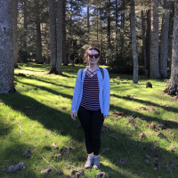 A person standing in a forest