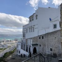 A white building looking over the sea