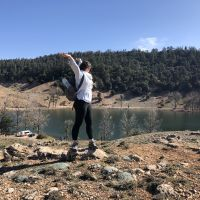 A person standing at the top of a hill next to Wiwan lake