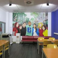 Mural of students in study lounge at IES Abroad Barcelona Center