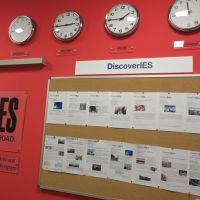 Bulletin board and clocks on wall at IES Abroad Barcelona Center