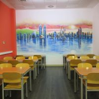 Classroom featuring a painting of the Barcelona skyline at IES Abroad Center