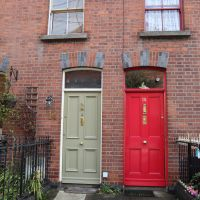 Red and Beige doors to row houses in Dublin