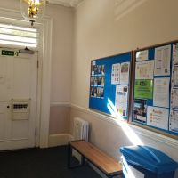 entry of London Center with bulletin boards