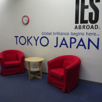 IES Abroad Tokyo wall with logo and red chairs