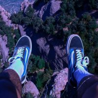 Intern's feet hanging over cliff in park over Barcelona
