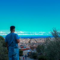 Intern with his back to camera viewing Barcelona from Montserrat