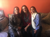 photo of me and my roommate with my host mom in Meknes